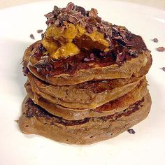 Chocolate pancakes made with 1 banana 1 egg 1 scoop of chocolate sun warrior protein powder and topped with almond butter cacao nibs and a little squeeze of manuka honey #organic #protein #sunwarrior #chocolate #pancakes #wheatfree #glutenfree #dairyfree #grainfree #paleo #primal #jerf #aip #lowcarb #lchf #healthy #fitness #gym #gymlife #muscle #lifestyle by glutenfree_gelder