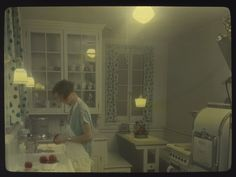 Woman in kitchen, circa 1930s | Flickr - Photo Sharing!