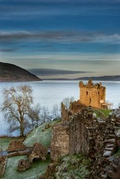 Incredible image of mysterious ruins of the medieval castle of Urquhart in Scotland.