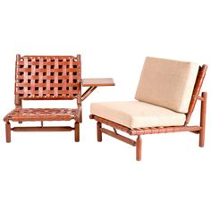 Pair of Ilmari Tapiovaara Armchairs ca.1957. Pair of armchairs: woven leather straps, wooden structure . Side table attached to one