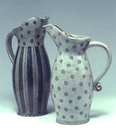 Ceramics by Karen Bunting at Studiopottery.co.uk - Two jugs, tallest 35cm. All pots shown are either incised and inlaid with oxides, or painted with oxides over the raw glaze. Photograph: Stephen Brayne.