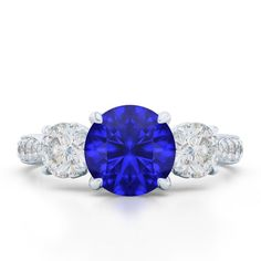 To Have and to Hold Classic Three Stone Engagement #ring in signature ribbon hearts mounting. Finished in White Gold Blue Sapphire and #Diamonds. http://jangmijewelry.com/