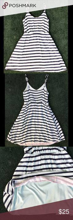 Lauren Conrad Navy Blue Stripped Mini Dress Lauren Conrad Navy Blue Stripped Mini Dress, spaghetti straps, adjustable straps, size 6 • 11-1/2 inch stretchy waist •30 inch length LC Lauren Conrad Dresses Mini