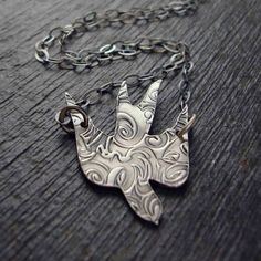 Cool texture on this metal bird necklace :) #birds