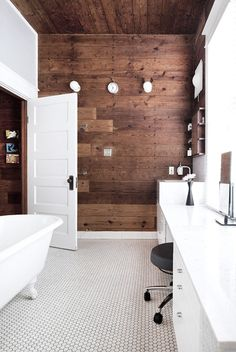 White bathroom with rich wood plank wall