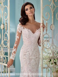 David Tutera - Tulle over satin fit and flare cage dress with hand-beaded Alencon lace appliqués, illusion and lace long sleeves, illusion bateau neckline, dipped faux off-the-shoulder bodice, lace ap