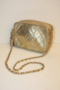 CHANEL - gold leather bag, logo on the front, a ponpom farm ture, beige leather interior, shoulder leather interlaced gold gilded metal. Hologram