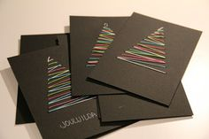 Red cardstock with green or gold thread, or blue cardstock with silver or white thread. Easy!
