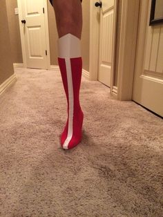 DIY Wonder Woman boots that my mom & I made for my costume! Super cheap & easy to make!! Materials: 1 pair of high-heels with skinny heel 1 pair of tall red socks (I used softball socks) White duct tape Card stock paper Tape Directions: Stretch the socks over the high-heels and cut a small hole in the heel of the sock for the heel of the shoe to poke through. Cut a piece of white duct tape to go up the front of each sock. Last, cut a piece of cardstock paper like so and tape it at the top of eac