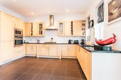 Newly refurbished kitchen with granite surfaces and fully integrated appliances. Wood decor. Wood kitchen.