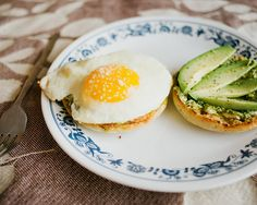 Pesto and cream cheese on an english muffin with sliced avocado and a big fat gooey egg on top. :) Yum!