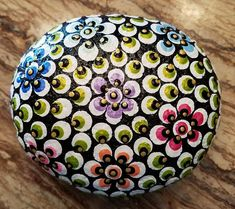5 round Mandala on river rock with Swarovski crytals, clear coat sealed
