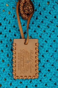 Turquoise crocheted rope, brown braided leather  Two top handles Detachable designer tag Internal patch, cell phone and zip-fastening pockets Fully lined in tan canvas Open at top
