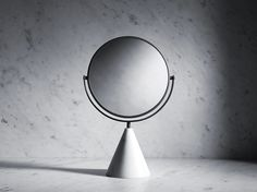 The delicate touch and bold geometric forms that characterise the Fontane Bianche collection of basins and tapware continue in the new range of accessories created by Elisa Ossino together with Salvatori. The mirror is a mini-sculpture which is designed to sit beautifully not only in the bathroom but equally in the bedroom or dressing room with its conical base in 100% natural stone, hand finished in our Tuscan workshop. The Fontane Bianche table mirror is available in Bianco Carrara and…