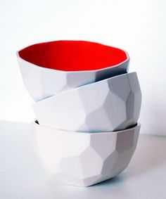 Red Geometric Ceramic Bowls - love the texture and the facets on the outside; the bright colors on the inside make the bowl pop