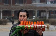 Nan Weiping, played a musical instrument made of carrots and scallions in Beijing on Thursday. Nan and his brother are musicians who specialize in performing with instruments made of vegetables and other food. Folk Rock, Singer Songwriter, World 2020, Talent Show, Pictures Of The Week, Absolutely Fabulous, World Music, Musical Instruments, Love Food