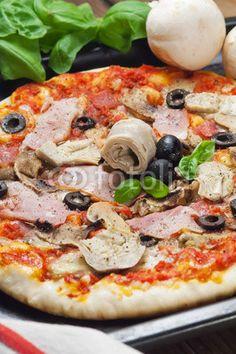 Pizza capricciosa: mushrooms, olives, artichokes, ham , mozzarella, tomatoes