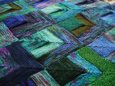 Mitred squares knitted throw: Interesting variation of garter-stockinette-garter squares!