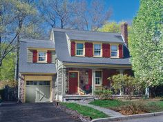 A vintage color palette and new, eco-friendly roofing pump up the exterior of this Dutch Colonial home.