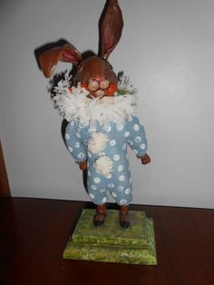 "RABBIT WITH CARROT, 12.5"" tall, 2013 Original Debra Schoch piece, has unsual felt painted body.  Paper Clay Material."