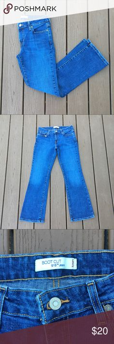 """Levi 515 Bootcut Jeans In a medium wash, these boot jeans by Levi's are an excellent staple piece. The flared detail makes for a great item. Made from cotton and spandex. In good condition. Approximate measurements lying flat: 28"""" inseam. 20254 Levi's Jeans Boot Cut"""
