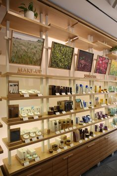 Visual imagery above shelving retail display shelves, store displays, displ Retail Display Shelves, Store Displays, Retail Displays, Window Displays, Vitrine Design, Retail Store Design, Retail Stores, Cosmetic Shop, Store Interiors
