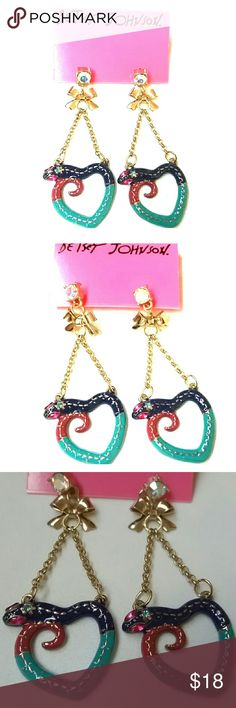 """Betsey Johnson Snake Heart Dangle Earrings NEW New with original holding card Betsey Johnson shiny gold tone enameled earrings, with snakes in teal, purple, and dark pink, with magenta crystal eyes and a blue crystal on the back of heads, forming the shape of hearts, hanging from double chains and bow with large aurora borealis crystal post stud with bullet backing. The drop is about 2.5"""" long from the AB crystal, and they are a little over 1"""" wide.  Thank you for checking out my closet, and…"""