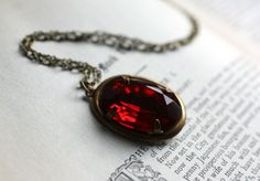 Heart. Vintage Ruby Jewel Necklace. Dark Ruby Necklace. $27.00, via Etsy.