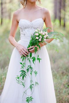 Cascading rose and fern bouquet | Lindy Yewen Photography | See more: http://theweddingplaybook.com/romantic-woodland-wedding-inspiration/