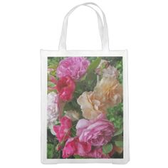A pretty reusable shopping bag displays an image of beautiful red, pink, apricot and white antique heritage roses set off by their pretty green foliage. Perfect for the rose lover or gardener!