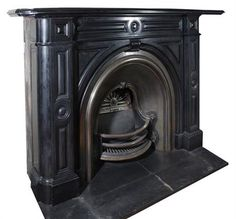 A Victorian marmo nero Belgio and iron mounted chimneypiece, circa 1870, the rectangular shelf with moulded edges, the frieze below with central bullseye flanked by panels, above a lobed 'keystone' and conforming spandrels, the projecting jambs also with bullseyes between recessed panels, the arched steel insert with two rail bowfronted iron grate