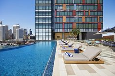 Enjoy premium cocktails, international wines and gourmet snacks, with Sydney skyline views, at the rooftop pool bar of a contemporary 5-star hotel.