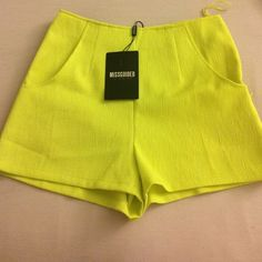 Highwaisted lime green shorts size 4 High waisted lime green shorts, bought them online and didn't fit. Never worn them! The tag says size 8 because it's from the UK but is a U.S. Size 4. Missguided Shorts