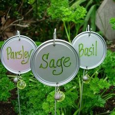 Recycle lids of aluminum cans into garden markers. What a clever idea!