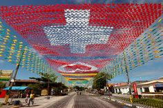 Flags of the participants in the 2014 World Cup are hung over a street in the town of Santa Cruz Cabralia, north of Porto Seguro, Brazil.