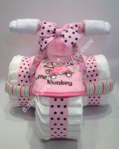 Pink for girl tricycle diaper cake http://babyfavorsandgifts.com/diaper-cakes-baby-girl-c-3_22.html