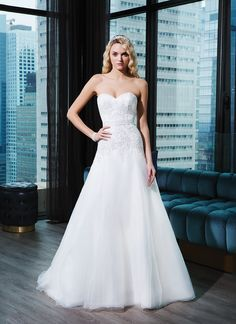Justin Alexander Signature Wedding Dress Style 9767 Tulle, caviar beading in deco motif A-line dress emphasized by a sweetheart neckline.