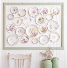 Create an elegant wall display with porcelain dishes, like Johanna Love inside Somerset Home.