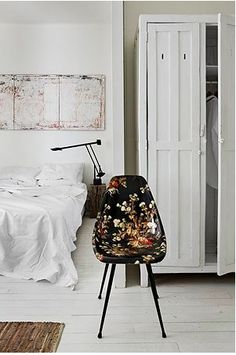 floral chair & white cupboard