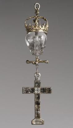 A sixteenth-century Mexican or Flemish silver-gilt and rock-crystal pendant depicting a skull wearing an imperial crown, with crossbones and a cross beneath. (Metropolitan Museum of Art)