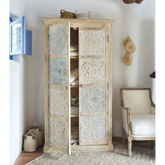 wood carved armoire with floral motifs and painted in white and silver