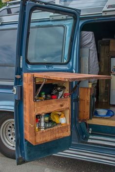 Use of every bit of storage in the van - van back door storage with flip up table, from Vantastic Voyage. Could work in a campervan, motorhome or even a tiny house or shed project.