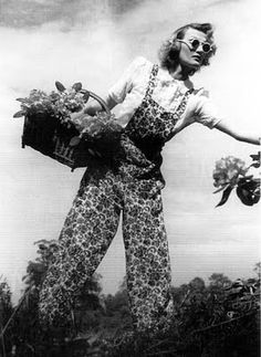Sassy '70's inpired Dorothy (from the Wizard of Oz). Also I love the overalls & circular sunnies & floral overalls.