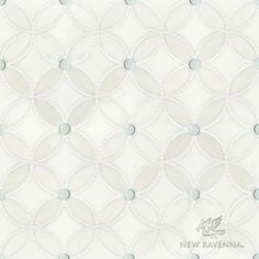 Esferitas, a waterjet and hand-cut stone and Serenity glass and mosaic, shown in honed Paperwhite, tumbled Thassos, and Tropical White glass, is part of the Parterre Collection by Sara Baldwin and Paul Schatz for New Ravenna.