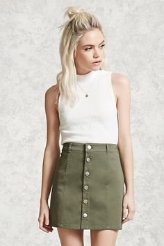 A stretch twill mini skirt featuring an A-line silhouette, button-front and seam-stitched panels.