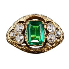 Antique Emerald and Mine-Cut Diamond Ring | From a unique collection of vintage cocktail rings at http://www.1stdibs.com/jewelry/rings/cocktail-rings/
