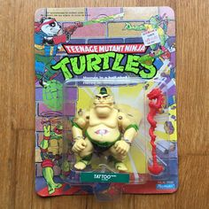 1991 Wave 4 TMNT TATTOO, unpunched, mint on a rare GOOD GUY card with red staff - this one has the tattoo on his belly, which is extremely super turbo rare. Ninja Turtle Toys, Teenage Mutant Ninja Turtles, Neca Figures, Action Figures, Vintage Toys, Retro Vintage, Tmnt Characters, Super Turbo, Cartoon Toys