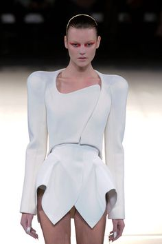Futuristic Fashion - structured silhouette and 3d sculptural shoulders // Thierry Mugler