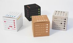 A calendar on a reversible white cardboard cube