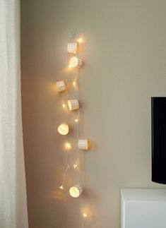 Pretty Wall Decor With #Fairy Lights & Cupcake Holders | #fairylights #fairylight #fairy #lights #stringlights